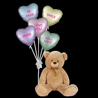 דובי ענק עם בלוני לבבות